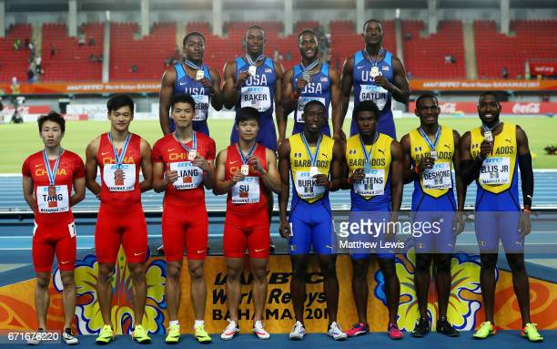 Team USA first place team Barbados second place and team China third place celebrate on the podium after the Men's 4 x 100 Meters Relay Final during...