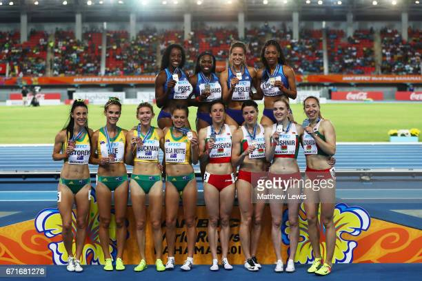 Team USA first place team Belarus second place and team Australia third place pose on the podium after the Women's 4 x 800 Meters Relay during the...