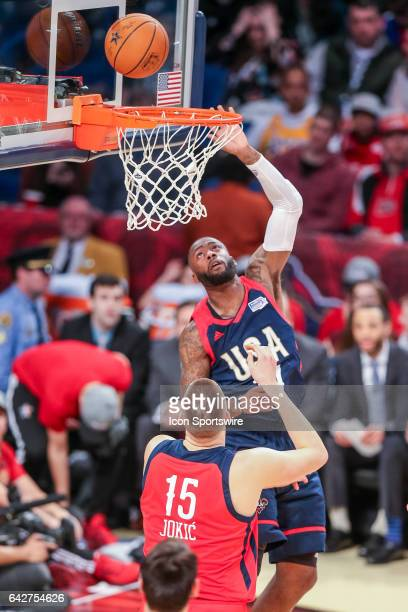 Team USA guard Jonathon Simmons taps the ball in against Team World center Nikola Jokic during the BBVA Rising Stars Challenge game between USA and...