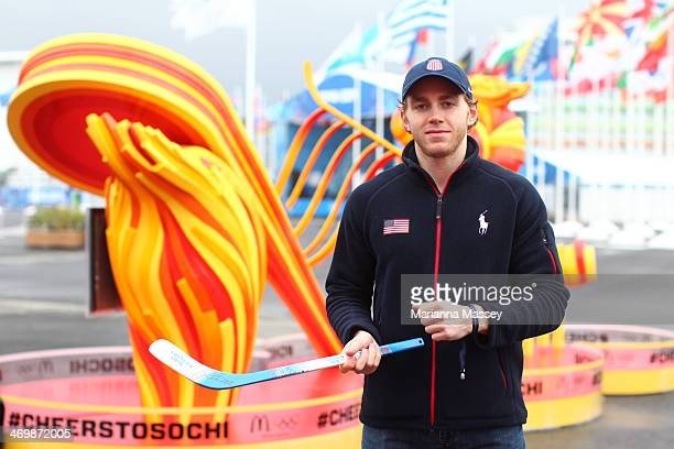 Team USA hockey player Patrick Kane visits the McDonald's Cheers To Sochi kiosk in the athlete village to read good luck messages sent from fans...