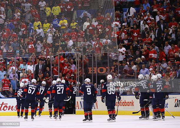 Team USA leaves the ice following a 42 loss to Team Canada during the World Cup of Hockey tournament at the Air Canada Centre on September 20 2016 in...