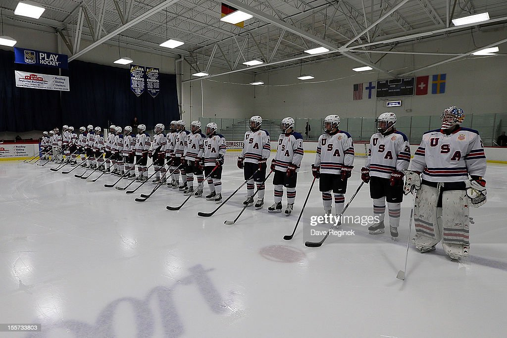 Team USA lines up on the blue line for the pre-game ceramonies before game two of the U-18 Four Nations Cup on November 7, 2012 at the Ice Cube arena in Ann Arbor, Michigan. Switzerland won in a shoot-out 5-4