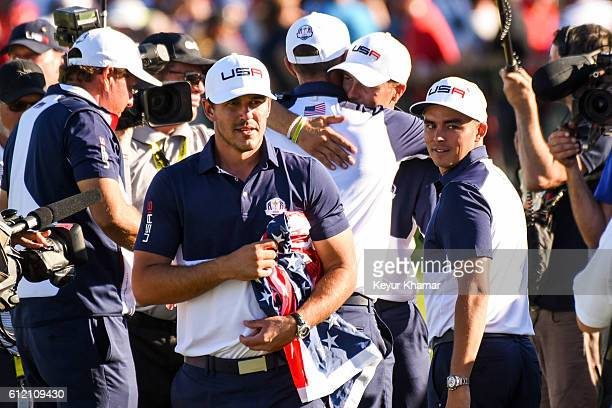 Team USA members Brooks Koepka Dustin Johnson Jordan Spieth and Rickie Fowler celebrate their victory on the 18th hole during singles matches of the...