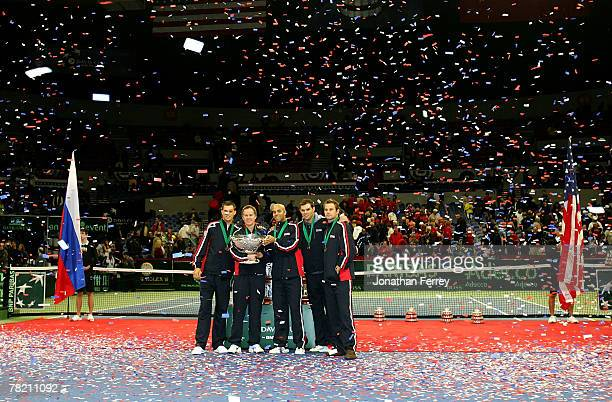 Team USA Mike Bryan Captain Patrick McEnroe James Blake Bob Bryan and Andy Roddick hoist the Davis Cup trophy after defeating Russia 41 during the...