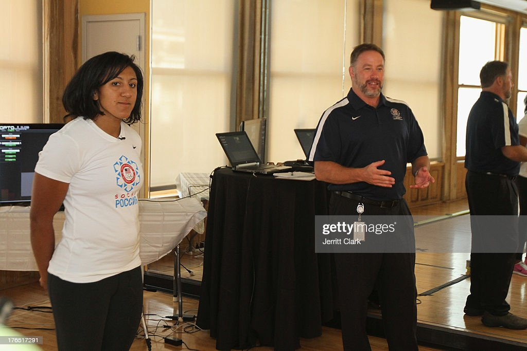 Team USA Olympian <a gi-track='captionPersonalityLinkClicked' href=/galleries/search?phrase=Elana+Meyers&family=editorial&specificpeople=5631239 ng-click='$event.stopPropagation()'>Elana Meyers</a> and High Performance Director Scott Riewald speaks at the Team USA High Performance Training Experience at 24 Hour Fitness on August 14, 2013 in New York City.