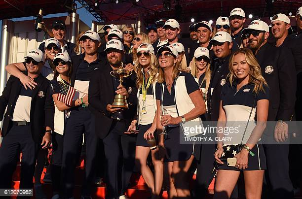 Team USA players and wives celebrate during the trophy ceremony after the Singles Matches during the 41st Ryder Cup at Hazeltine National Golf Course...