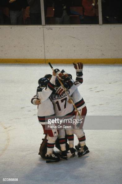 Team USA players gather in the midle of the rink to celebrate after defeating team Russia during the XIII Olympic Winter Games in February of 1980 in...
