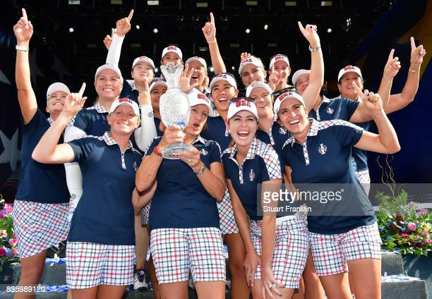 Team USA pose with the Solheim Cup after beating Team Europe 16 1/2 to 11 1/2 during closing ceremony of The Solheim Cup at Des Moines Golf and...