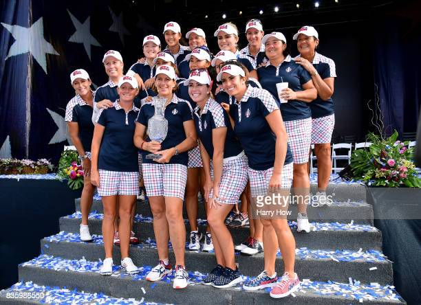 Team USA pose with the Solheim Cup after closing ceremony of the Solheim Cup at the Des Moines Golf and Country Club on August 20 2017 in West Des...