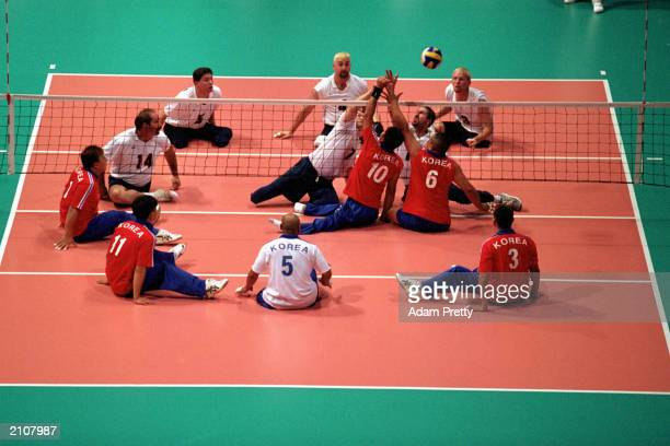 Team USA spike the ball over the net in Men's Sitting Volleyball Quaterfinals against Team Korea during the Sydney 2000 Paralympic Games on October...