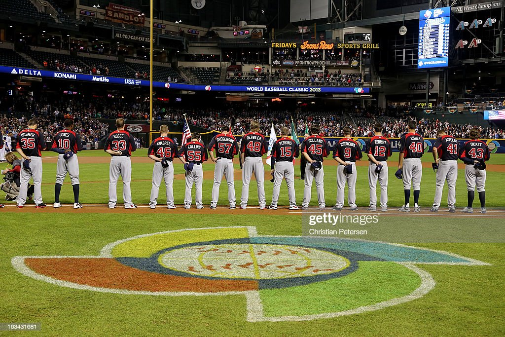 Team USA stands on the baseline for the national anthem prior to the World Baseball Classic First Round Group D game against italy at Chase Field on March 9, 2013 in Phoenix, Arizona.