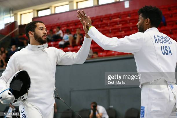 Team USA Teammates Benjamin Bratton and Adam Rodney share a highfive after a bout during the Team Men's Epee event on June 17 2017 at the PanAmerican...