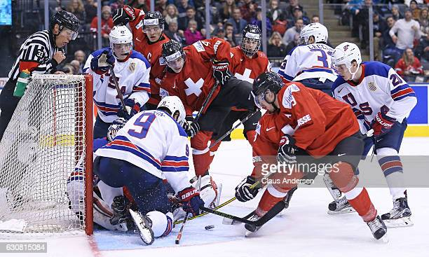 Team USA tries to hold the fort in a scramble against Team Switzerland during a QuarterFinal game at the 2017 IIHF World Junior Hockey Championships...