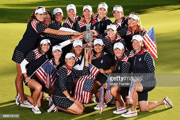 Team USA with Juli Inkster captain of team USA hold the Solheim Cup trophy after the final day of The Solheim Cup at St LeonRot Golf Club on...