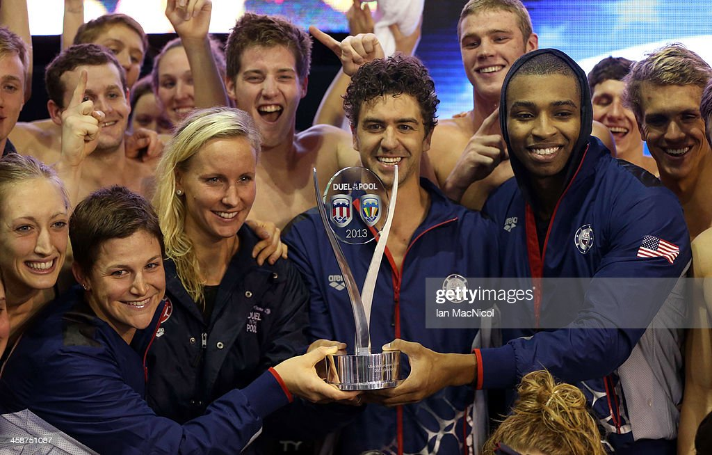 Team USA's <a gi-track='captionPersonalityLinkClicked' href=/galleries/search?phrase=Anthony+Ervin&family=editorial&specificpeople=3232464 ng-click='$event.stopPropagation()'>Anthony Ervin</a> (C), <a gi-track='captionPersonalityLinkClicked' href=/galleries/search?phrase=Jessica+Hardy&family=editorial&specificpeople=540355 ng-click='$event.stopPropagation()'>Jessica Hardy</a> (L) and <a gi-track='captionPersonalityLinkClicked' href=/galleries/search?phrase=Cullen+Jones&family=editorial&specificpeople=1047215 ng-click='$event.stopPropagation()'>Cullen Jones</a> (R) pose with the trophy after victory during Day Two of Duel In The Pool at Tollcross International Swimming Centre on December 21, 2013 in Glasgow, Scotland.