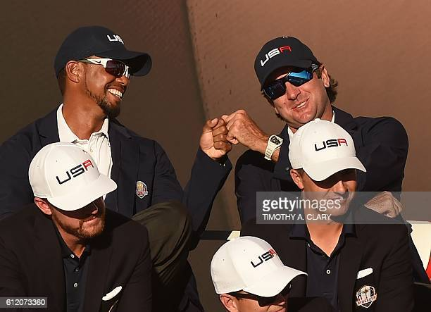 Team USA's Vice Captain's Tiger Woods and Bubba Watson celebrate during the trophy ceremony after the Singles Matches during the 41st Ryder Cup at...