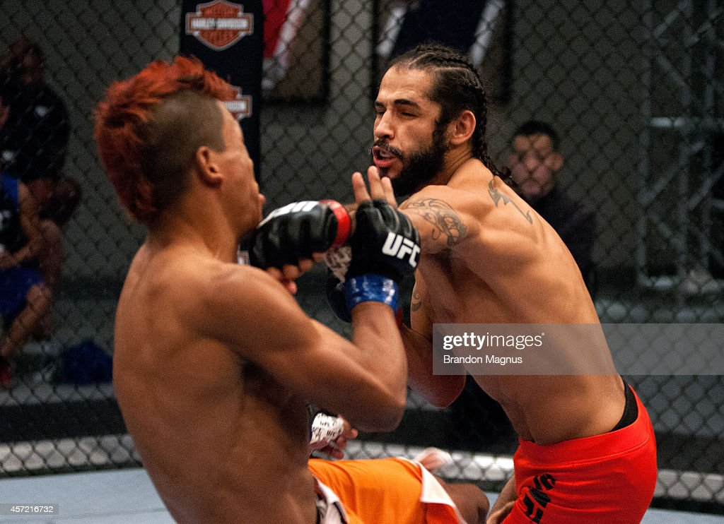 Team Velasquez fighter Masio Fullen punches team Werdum fighter Leonardo Morales up against the cage in their preliminary fight during filming of The...