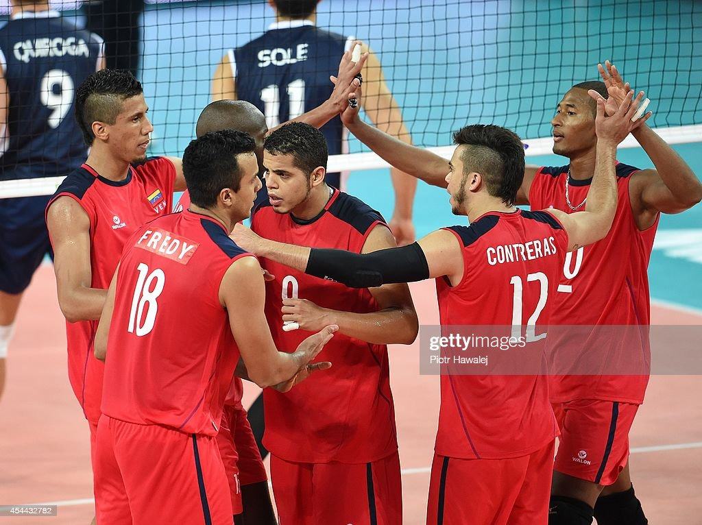 Team Venezuela celebrate after winning a point during the FIVB World Championships match between Venezuela and Argentina on August 31, 2014 in Wroclaw, Poland.