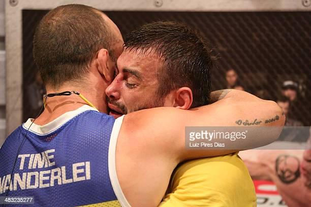 Team Wanderlei fighter Ricardo Abreu is embraced by coach Wanderlei Silva after defeating Team Sonnen fighter Guilherme de Vasconcelos in their...