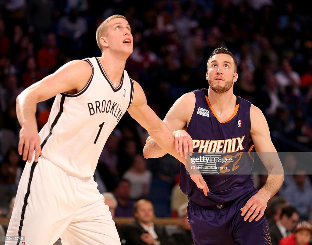 Team Webber's Mason Plumlee #1 of the Brooklyn Nets and Team Hill's Miles Plumlee #22 of the Phoenix Suns battle for position during the BBVA Compass Rising Stars Challenge 2014 as part of the 2014 NBA Allstar Weekend at the Smoothie King Center on February 14, 2014 in New Orleans, Louisiana.