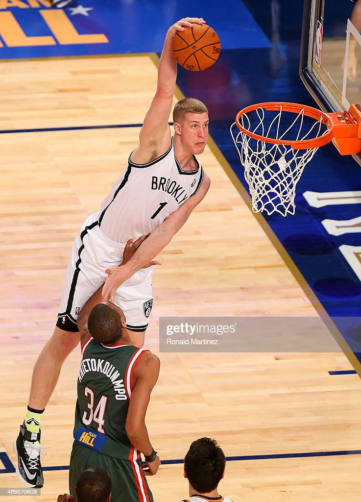 Team Webber's <a gi-track='captionPersonalityLinkClicked' href=/galleries/search?phrase=Mason+Plumlee&family=editorial&specificpeople=5792012 ng-click='$event.stopPropagation()'>Mason Plumlee</a> #1 of the Brooklyn Nets heads for the net as Team Hill's <a gi-track='captionPersonalityLinkClicked' href=/galleries/search?phrase=Giannis+Antetokounmpo&family=editorial&specificpeople=11078379 ng-click='$event.stopPropagation()'>Giannis Antetokounmpo</a> #34 of the Milwaukee Bucks defends during the BBVA Compass Rising Stars Challenge 2014 as part of the 2014 NBA Allstar Weekend at the Smoothie King Center on February 14, 2014 in New Orleans, Louisiana.