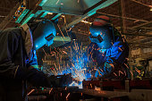 Team welder are welding in car factory