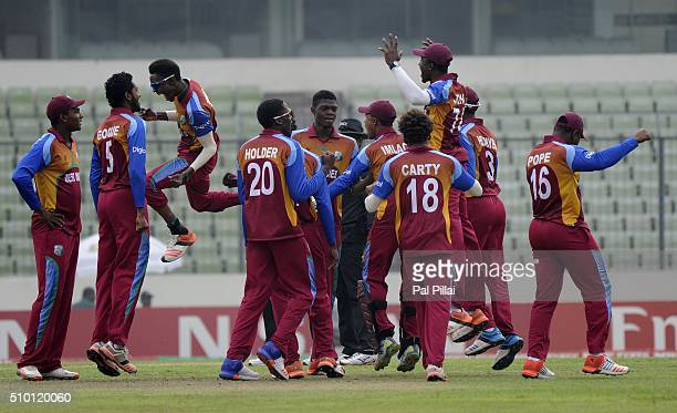 Team West Indies U19 celebrates the wicket of Rishabh Pant of India during the ICC U19 World Cup Final Match between India and West Indies on...