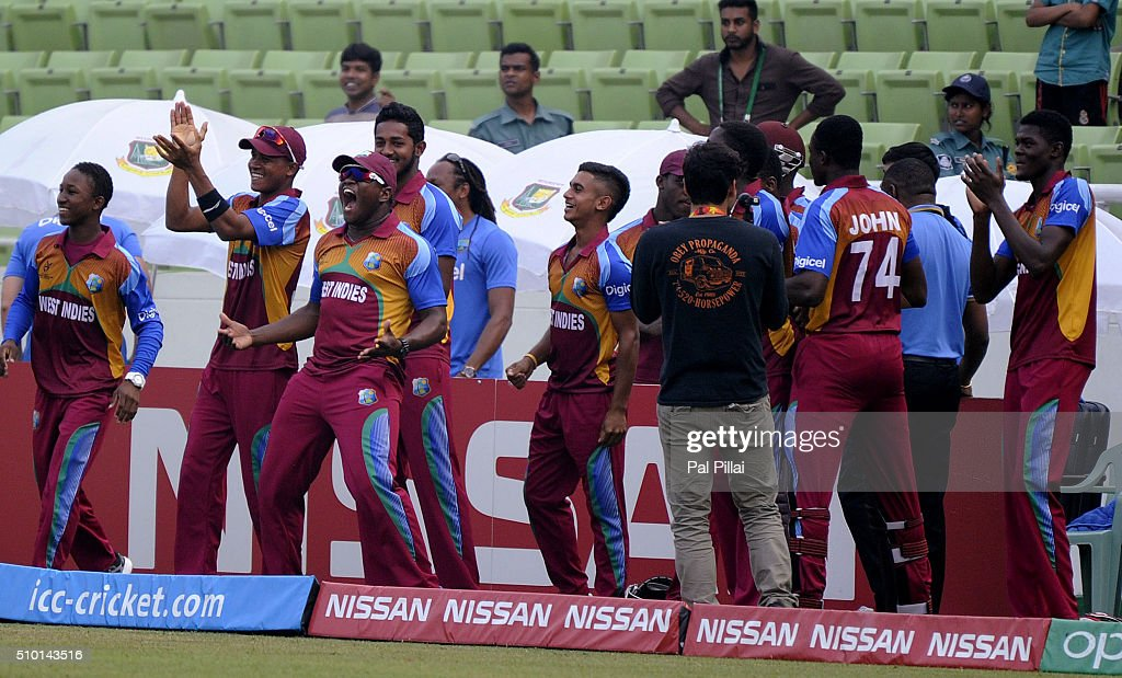 Team West Indies U19 start celebrating as they reach closer to the chase during the ICC U19 World Cup Final Match between India and West Indies on February 14, 2016 in Dhaka, Bangladesh.