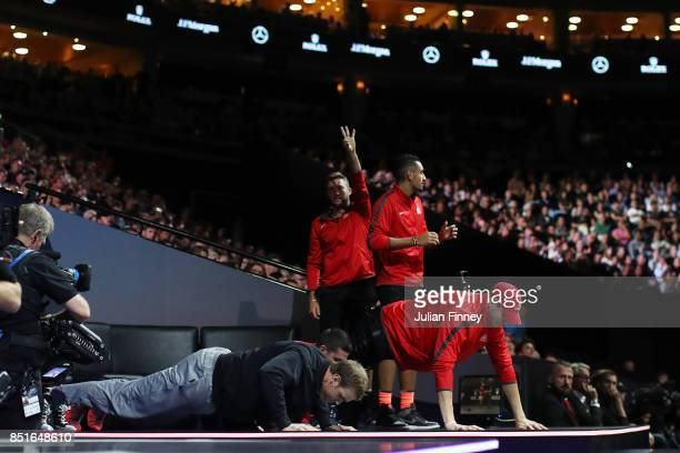 Team World do press up on the bench during as Denis Shapovalov of Team World plays his singles match against Alexander Zverev of Team Europe serevs...