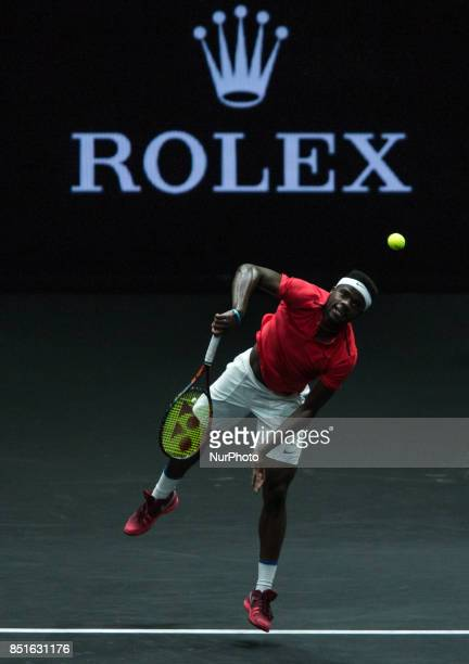 Team World player Frances Tiafoe of United States returns the ball to Team Europe player Marin Cilic of Croatia during the first day at Laver Cup on...