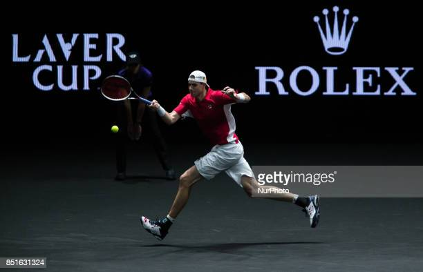 Team World player John Isner of United States returns the ball to Team Europe player Dominic Thiem of Austria during the first day at Laver Cup on...