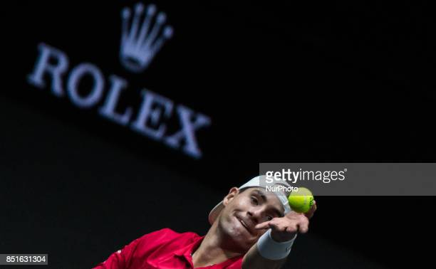 Team World player John Isner of United States serves against Team Europe player Dominic Thiem of Austria during the first day at Laver Cup on Sept 22...