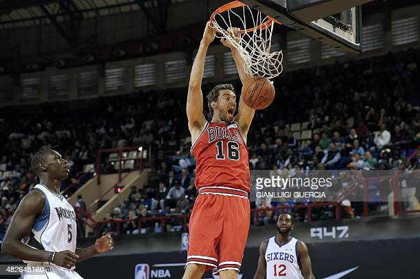 NBA Team World's Spanish player Pau Gasol of the Chicago Bulls scores during the NBA Africa basketball match between Team Africa and Team World on...