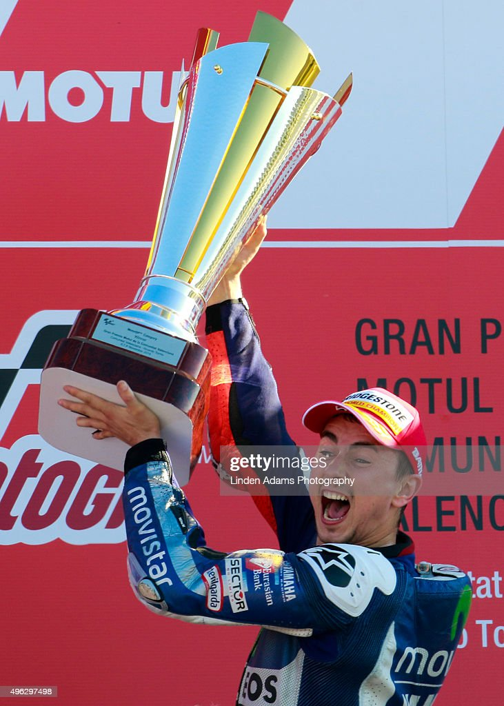 Team Yamaha Movistar's Jorge Lorenzo lifts the victory trophy at Comunitat Valenciana Ricardo Tormo Circuit on November 8, 2015 in Valencia, Spain. Jorge Lorenzo won the MotoGP title for the third time.