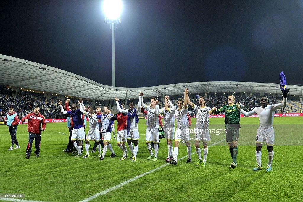 Team Zulte-Waregem celebrates the victory after the UEFA Europa League group D - matchday 4 match between NK Maribor 1960 and SV Zulte Waregem at Ljudski vrt stadium on November 07, 2013 in Maribor, Slovenia.