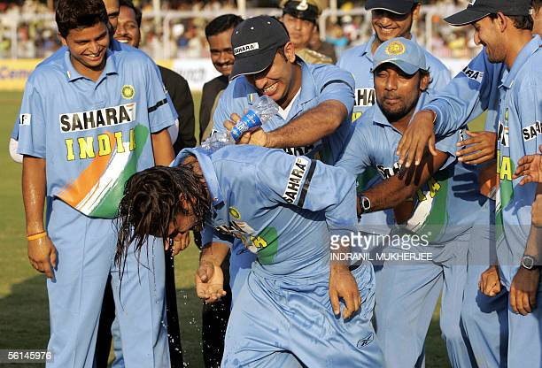 Teamamtes pour water on ManoftheSeries Mahendra Singh Dhoni during the prize distribution ceremony after the seventh and final one day international...