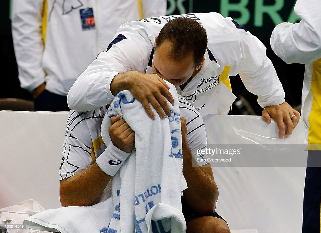 Teamate Bruno Soares consoles Thiago Alves of Brazil following his loss to Sam Querrey of the United States during day three of the Davis Cup first round match between the U.S. and Brazil at Veterans Memorial Arena on February 3, 2013 in Jacksonville, Florida.