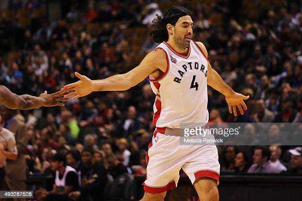 TORONTO ON  OCTOBER 18 A teammate highfives Toronto Raptors Luis Scola after scoring against the Cleveland Cavaliers during the first half of their...