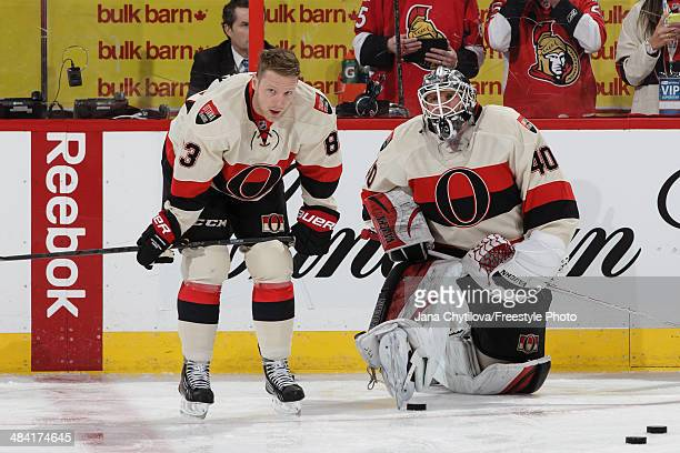 Teammates Ales Hemsky and Robin Lehner of the Ottawa Senators chat during warmups prior to an NHL game against the Montreal Canadiens at Canadian...