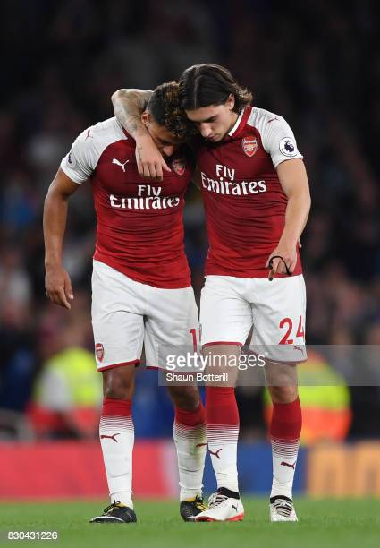 Teammates Alex OxladeChamberlain and Hector Bellerin of Arsenal celebrate following their team's 43 victory during the Premier League match between...