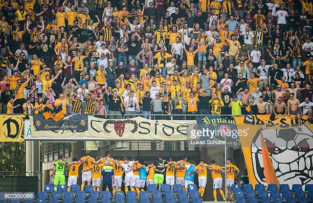 Teammates and fans of Dresden celebrate their victory after the Second Bundesliga match between Hannover 96 and SG Dynamo Dresden at HDIArena on...