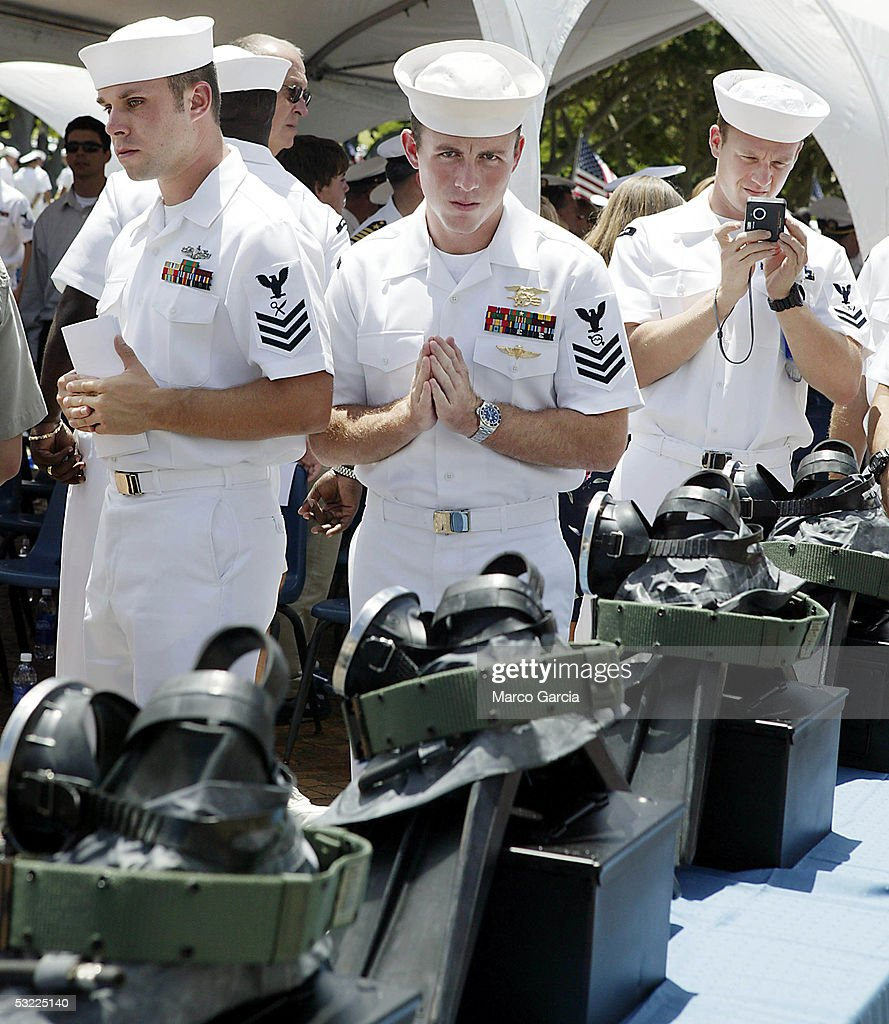 Teammates and friends of Pearl Harbor-based SEALs killed in action walk past a memorial of their fallen comrades military equipment during a memorial service held at the National Memorial Cemetery of the Pacific July 11, 2005 in Honolulu, Hawaii. The SEALs were killed during combat operations in Afghanistan on June 28.
