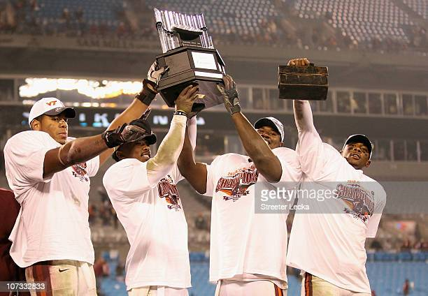 Teammates Andre Smith Tyrod Taylor John Graves and Davon Morgan of the Virginia Tech Hokies celebrate after winning the ACC Championship 4433 after...