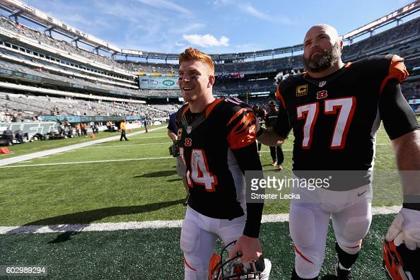 Teammates Andy Dalton and Andrew Whitworth of the Cincinnati Bengals celebrate after a 2322 victory over the New York Jets during their game at...