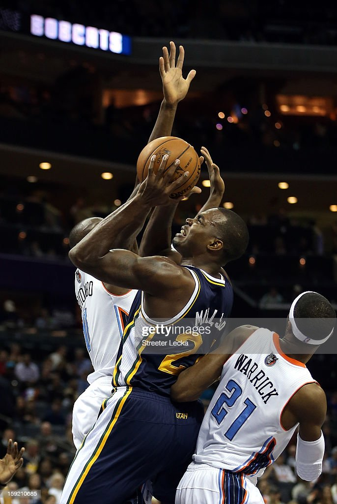 Teammates Bismack Biyombo #0 of the Charlotte Bobcats and Hakim Warrick #21 try to stop Paul Millsap #24 of the Utah Jazz during their game at Time Warner Cable Arena on January 9, 2013 in Charlotte, North Carolina.
