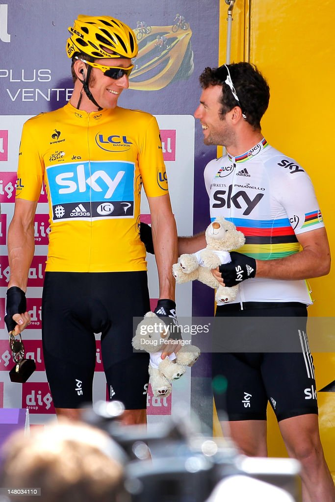 Teammates <a gi-track='captionPersonalityLinkClicked' href=/galleries/search?phrase=Bradley+Wiggins&family=editorial&specificpeople=182490 ng-click='$event.stopPropagation()'>Bradley Wiggins</a> of Great Britain in the race leader's yellow jersey and World Champion <a gi-track='captionPersonalityLinkClicked' href=/galleries/search?phrase=Mark+Cavendish&family=editorial&specificpeople=684957 ng-click='$event.stopPropagation()'>Mark Cavendish</a> of Great Britain take the stage as Team Sky Procycling was awarded the fastest team of the race prior to stage eight of the 2012 Tour de France from Belfort, France to Porrentruy, Switzerland on July 8, 2012 in Belfort, France.