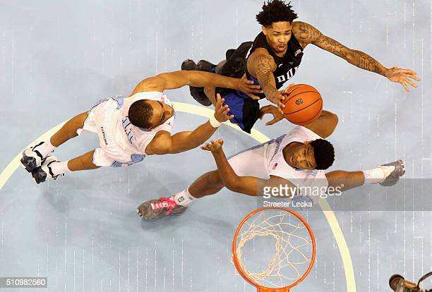 Teammates Brice Johnson and Kennedy Meeks of the North Carolina Tar Heels try to stop Brandon Ingram of the Duke Blue Devils during their game at...