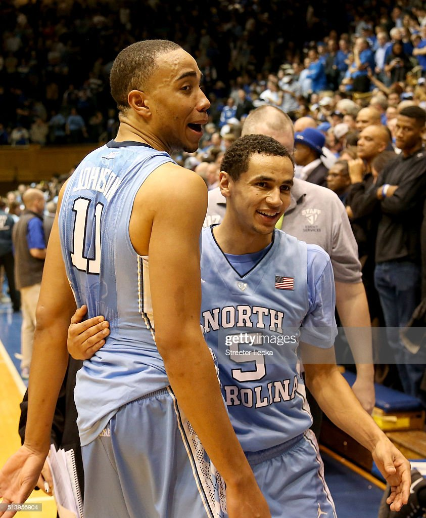 Teammates Brice Johnson and Marcus Paige of the North Carolina Tar Heels celebrate after defeating the Duke Blue Devils 7672 after their game at...