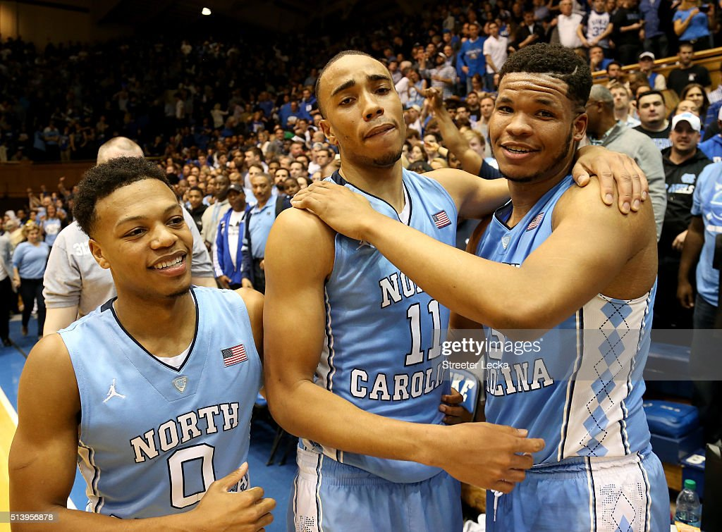 Teammates Brice Johnson Nate Britt and Kennedy Meeks of the North Carolina Tar Heels celebrate after defeating the Duke Blue Devils 7672 at Cameron...
