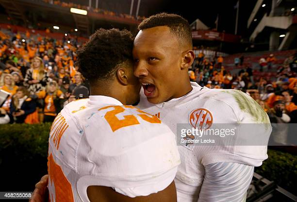Teammates Cameron Sutton and Joshua Dobbs of the Tennessee Volunteers celebrate after defeating the South Carolina Gamecocks 4542 in overtime at...